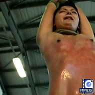 Reddened and sobbing, Sandra Ice swings from the rafters on a rope as her captor continues to dish out brutal torture