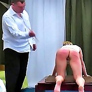 European chick in white gets bent over a table and caned brutally